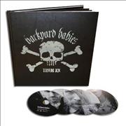 Click here for more info about 'Backyard Babies - Them XX [Photo Book] - Sealed'