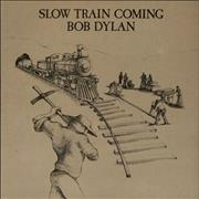 Click here for more info about 'Slow Train Coming'