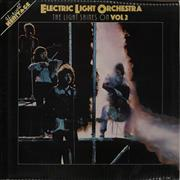 Click here for more info about 'Electric Light Orchestra - The Light Shines On Vol. 2 - laminated p/s'