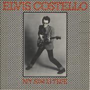 Click here for more info about 'Elvis Costello - My Aim Is True - Unlaminated Orange back'