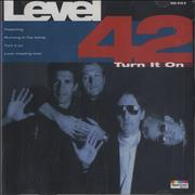 Click here for more info about 'Level 42 - Turn It On'