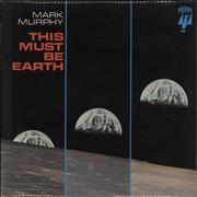 Click here for more info about 'This Must Be Earth'