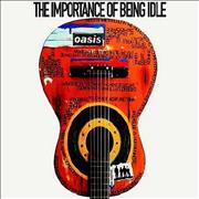 Click here for more info about 'Oasis (UK) - The Importance Of Being Idle'