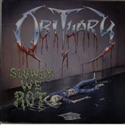 Click here for more info about 'Obituary - Slowly We Rot'