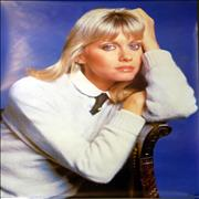 Click here for more info about 'Olivia Newton John by Rex Features'