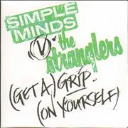Click here for more info about 'Simple Minds - (Get A) Grip (On Yourself)'