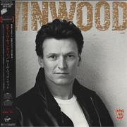 Click here for more info about 'Steve Winwood - Roll With It'