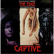 Click here for more info about 'The Edge (U2) - Captive - Promo Stamped'