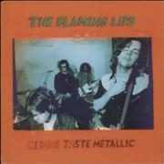 Click here for more info about 'The Flaming Lips - Clouds Taste Metallic - Green Vinyl - EX'