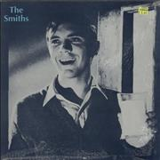 """The Smiths What Difference Does It Make - Stamp Sleeve with 'Smiths' logo UK 12"""" vinyl"""